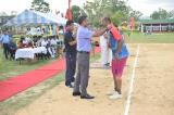 Shri Anshuman Yadav, IPS, IGP M&N giving away prizes to the player.