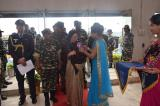 THE HONORABLE GOVERNOR OF MANIPUR SMT.NAJMA A.HEPTULLA-THE CHIEF GUEST OF THE CLOSING CEREMONY BEING PRESENTED A ROSETTE ON HER ARRIVAL AT KHUMAN LAMPAK STADUIM.