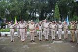 Officers Saluting The National Flag On Independence Day Celebration.